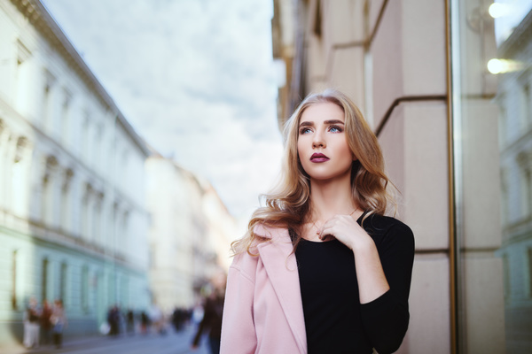 Fashionable blonde girl walking in the city Stock Photo 02