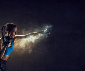 Fists in front of a black background female boxer Stock Photo