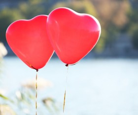 Floating two red balloons Stock Photo