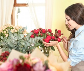 Florist working woman with red roses Stock Photo