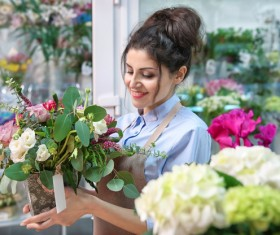 Flower shop work woman holding flowers Stock Photo
