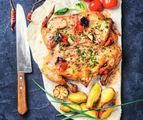 Fried potatoes with tomatoes and delicious fried chicken HD picture