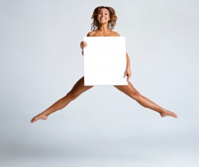 Girl holding a blank paper jumped high Stock Photo 01