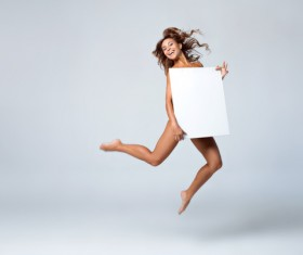 Girl holding a blank paper jumped high Stock Photo 02