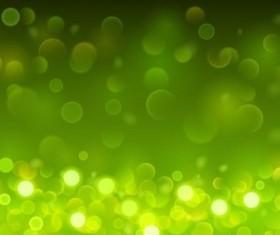 Green bokeh effect background vector