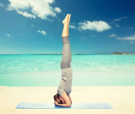 Handstand woman doing yoga Stock Photo