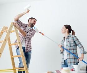 Happy couple's new home decoration Stock Photo
