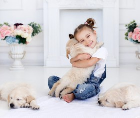 Happy little girl hugging the dog Stock Photo
