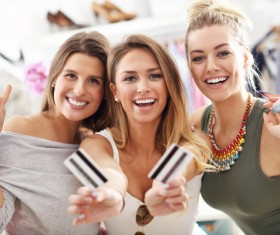 Happy woman holding a bank card to buy clothes HD picture