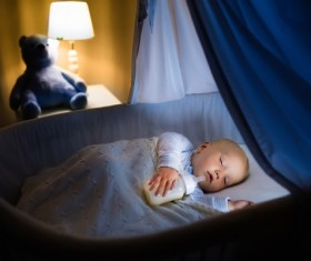 Holding a bottle of baby to sleep Stock Photo