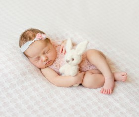 Holding a toy rabbit sleeping cute BB HD picture