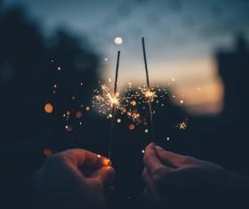 Holding burning fireworks Stock Photo