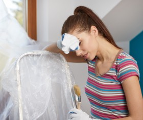 Housewife holding a brush rest Stock Photo