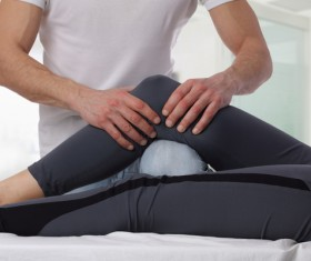 Joint massage therapy Stock Photo