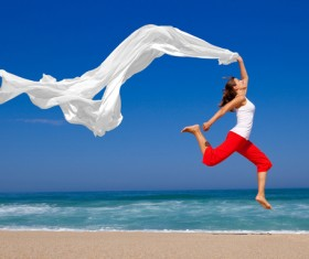Jumping woman waving white satin HD picture
