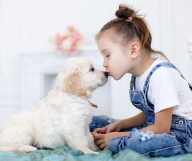 Kiss the little girl of the little dog Stock Photo