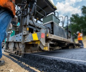 Laying asphalt pavement Stock Photo