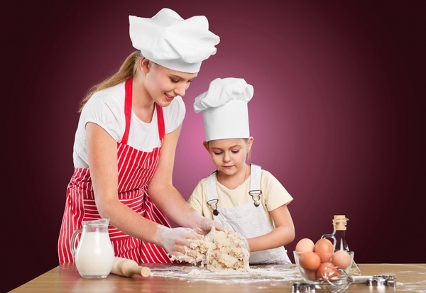 Learn dough with her mothers daughter Stock Photo