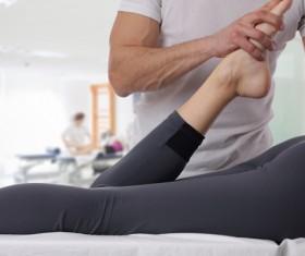 Leg massage therapy Stock Photo