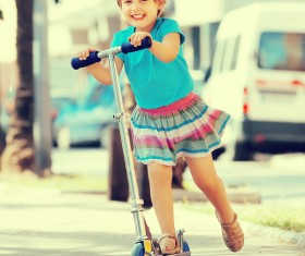 Little girl playing with a unicycle HD picture