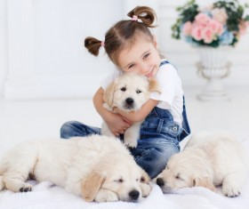 Little girl with pet dog Stock Photo