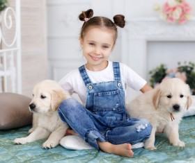 Little girl with two puppies Stock Photo