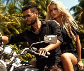 Man riding on a motorcycle with girlfriend Stock Photo