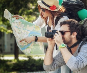 Maps and signs pointing tourists taking pictures Stock Photo