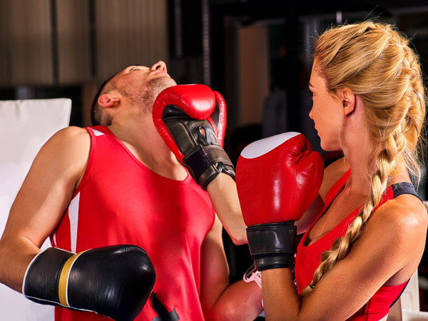 Boxing workout woman in fitness class. Sport exercise two people.