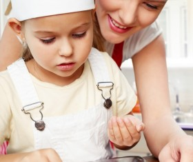 Mother and daughter making pastry together Stock Photo