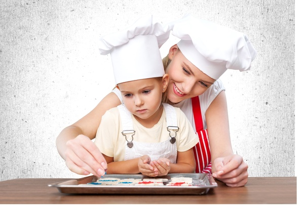 Mother and daughter with roasted snacks Stock Photo