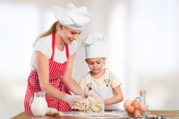 Mother taught her daughter to knead Stock Photo