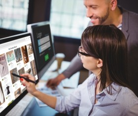 Office colleagues to check online products Stock Photo