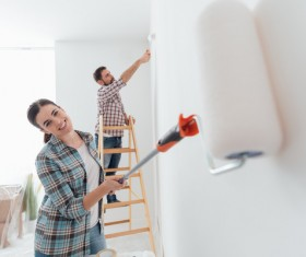 Paint the walls white couples Stock Photo