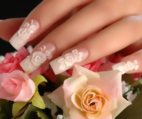 Pink rose carved nail Stock Photo
