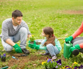 Planted flowers with father and daughter HD picture