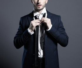 Playing black tie handsome man Stock Photo 01