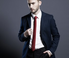 Playing red tie handsome man Stock Photo 03