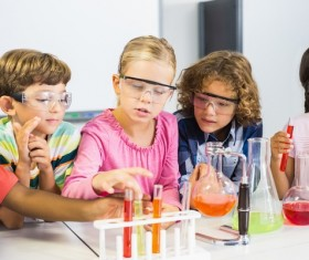 Pupils do chemistry experiments Stock Photo 01