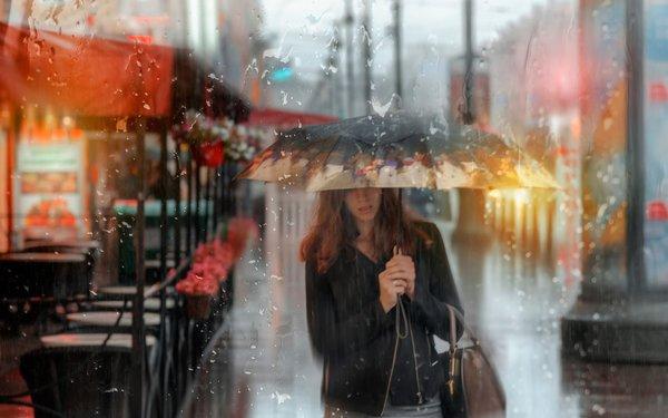 Rain umbrella walking woman Stock Photo