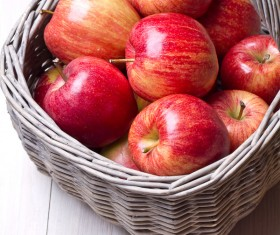 Red apple placed in the basket Stock Photo