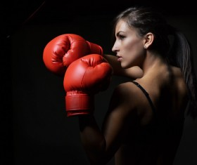 Red boxing gloves female boxer Stock Photo