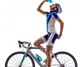Ride a bike player to drink water Stock Photo