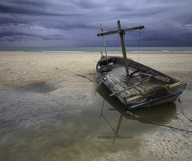 Seaside broken wooden boat Stock Photo