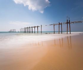 Seaside broken wooden bridge Stock Photo