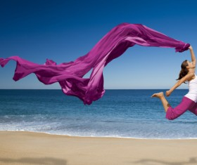 Seaside dancing woman with purple satin HD picture
