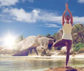 Seaside yoga woman Stock Photo 01