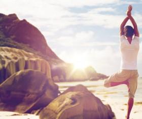 Seaside yoga woman Stock Photo 02