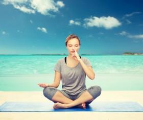 Seaside yoga woman Stock Photo 03