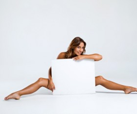 Sitting on the floor holding a blank paper girl Stock Photo